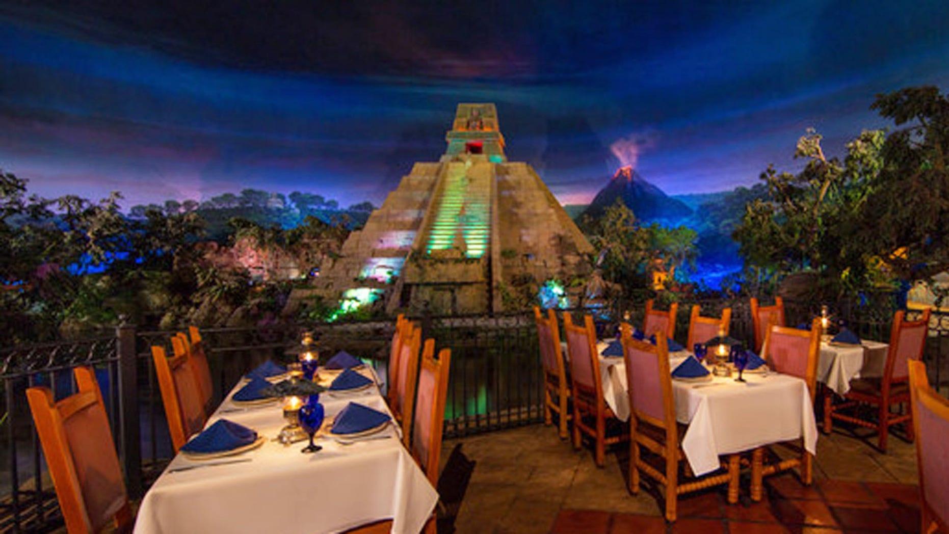 A tourist climbed the Mesoamerican pyramid at Epcot's Mexico Pavilion in Orlando.