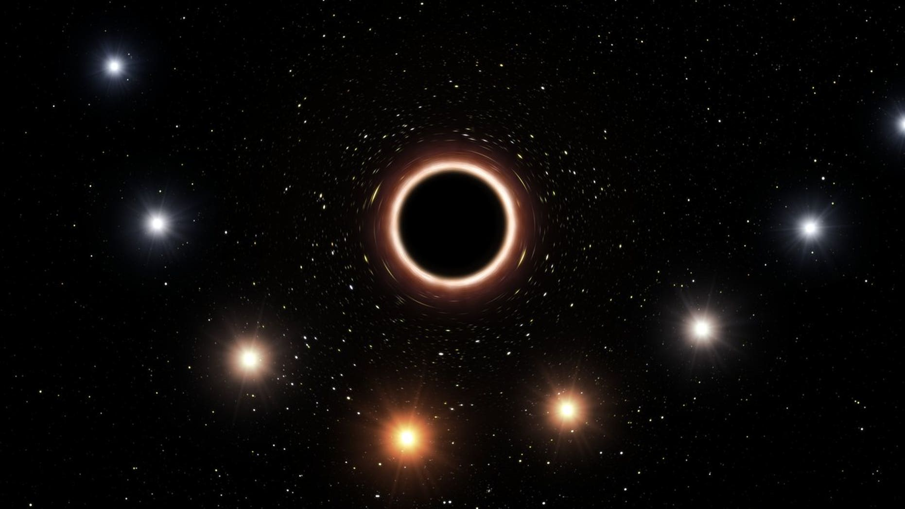 An artist's impression shows S2 traveling close to the supermassive black hole at the Milky Way's center.