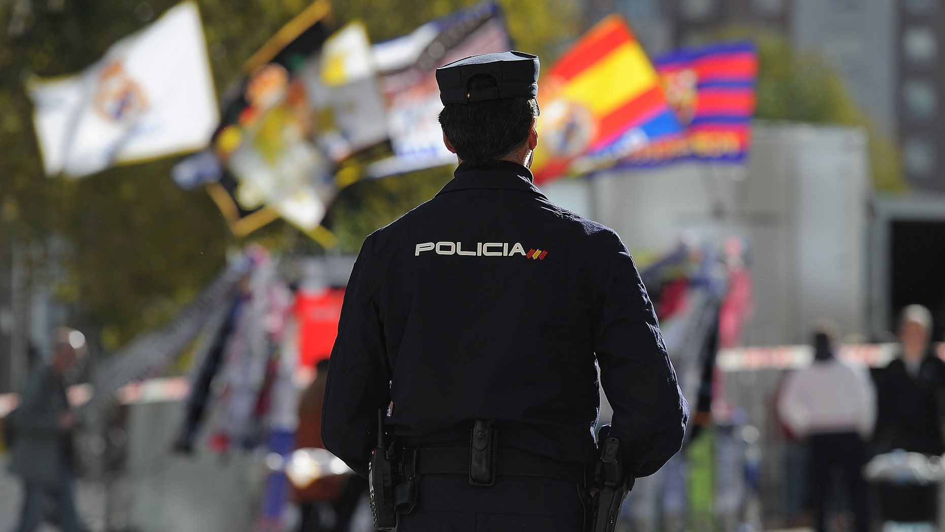 MADRID, SPAIN - NOVEMBER 21:  A policeman stands guard outside the Santiago Bernabeu stadium during tight security ahead of the La Liga match between Real Madrid and Barcelona at Estadio Santiago Bernabeu on November 21, 2015 in Madrid, Spain.  (Photo by Denis Doyle/Getty Images)