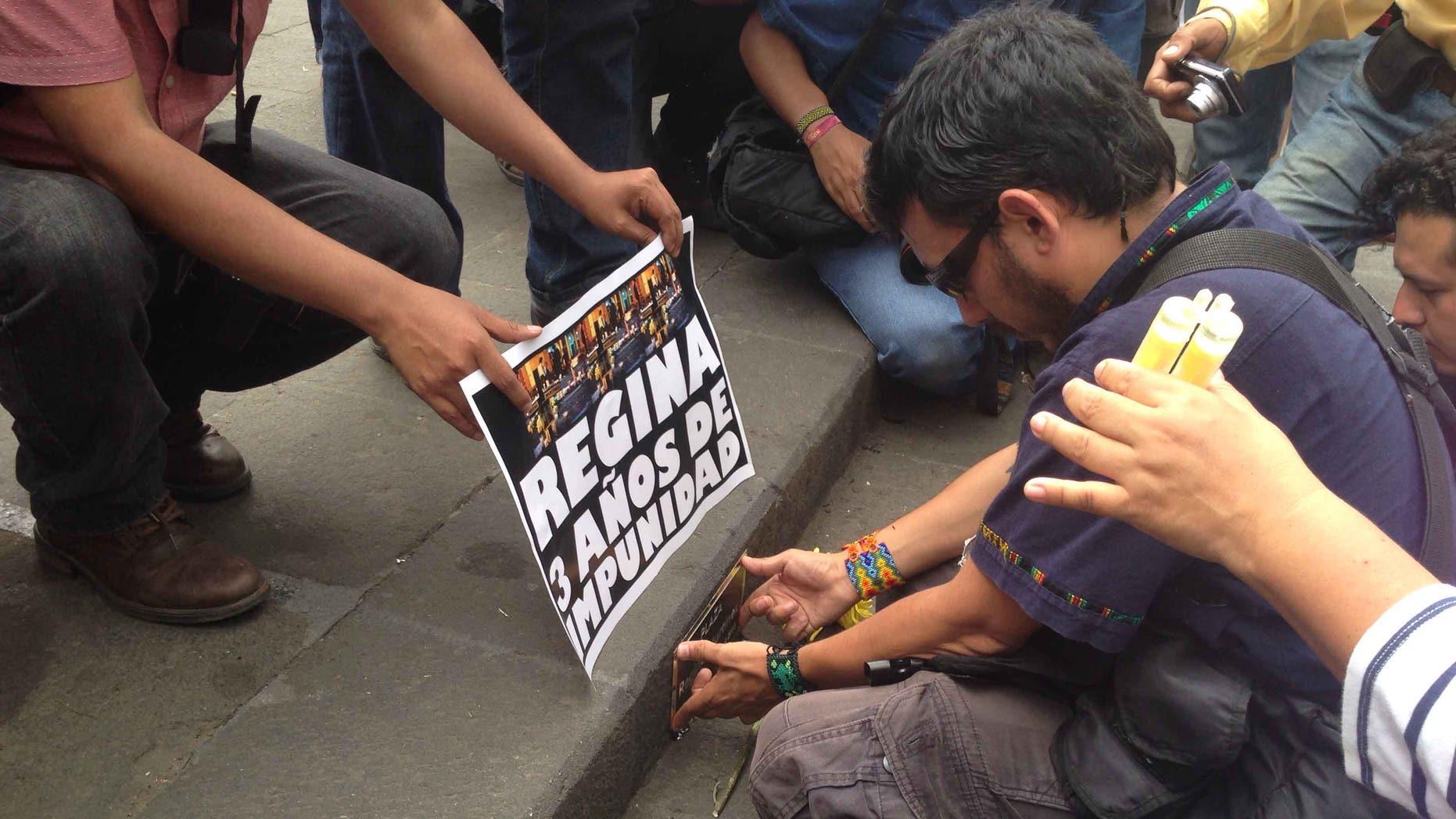 Ruben Espinosa on April 28, 2015, placing a plaque to rename a plaza after slain journalist Regina Martinez.