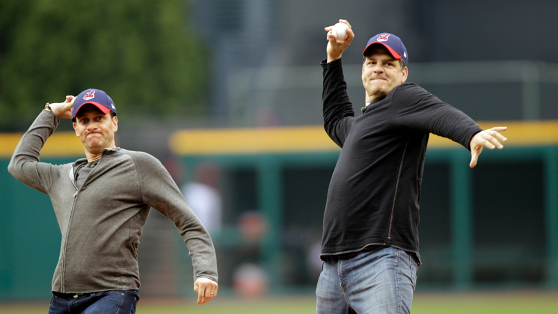 In this May 8, 2012, file photo, ESPN radio hosts Mike Greenberg, left, and Mike Golic throw out first pitches before a baseball game between the Cleveland Indians and the Chicago White Sox in Cleveland. The network announced Tuesday, May 16, 2017, that Greenberg would be leaving the longtime morning radio show he co-hosts with Golic to host a new morning TV show on ESPN TV that will premier Jan. 1.