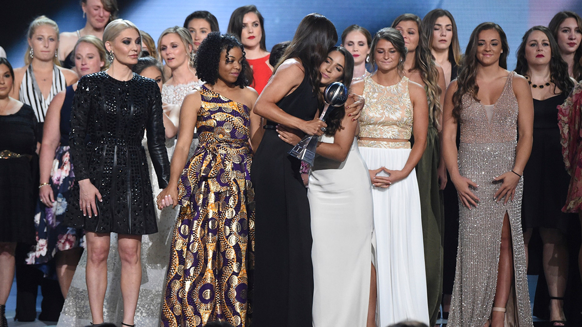 Jennifer Garner, front, embraces gymnast Aly Raisman after presenting the Arthur Ashe Award for Courage, at the ESPY Awards at Microsoft Theater on Wednesday, July 18 in Los Angeles.