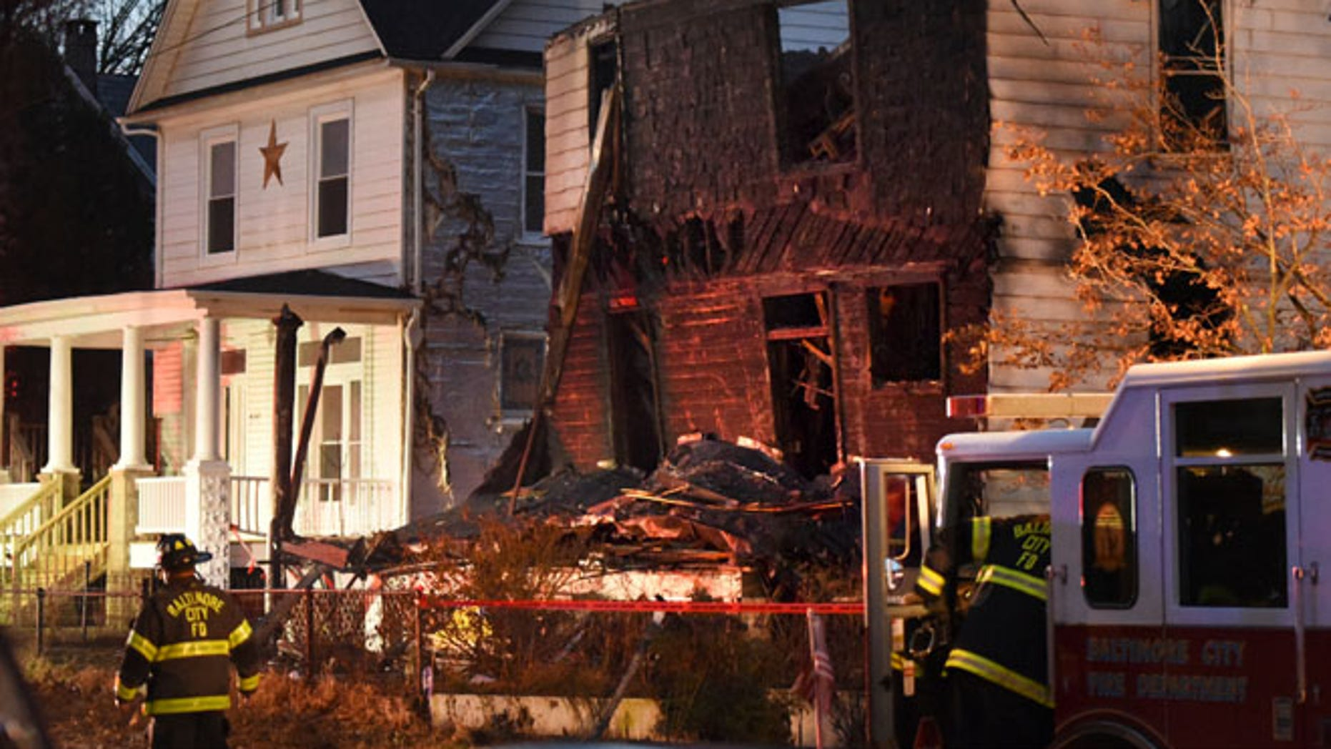 Baltimore City firefighters remain on the scene early Thursday