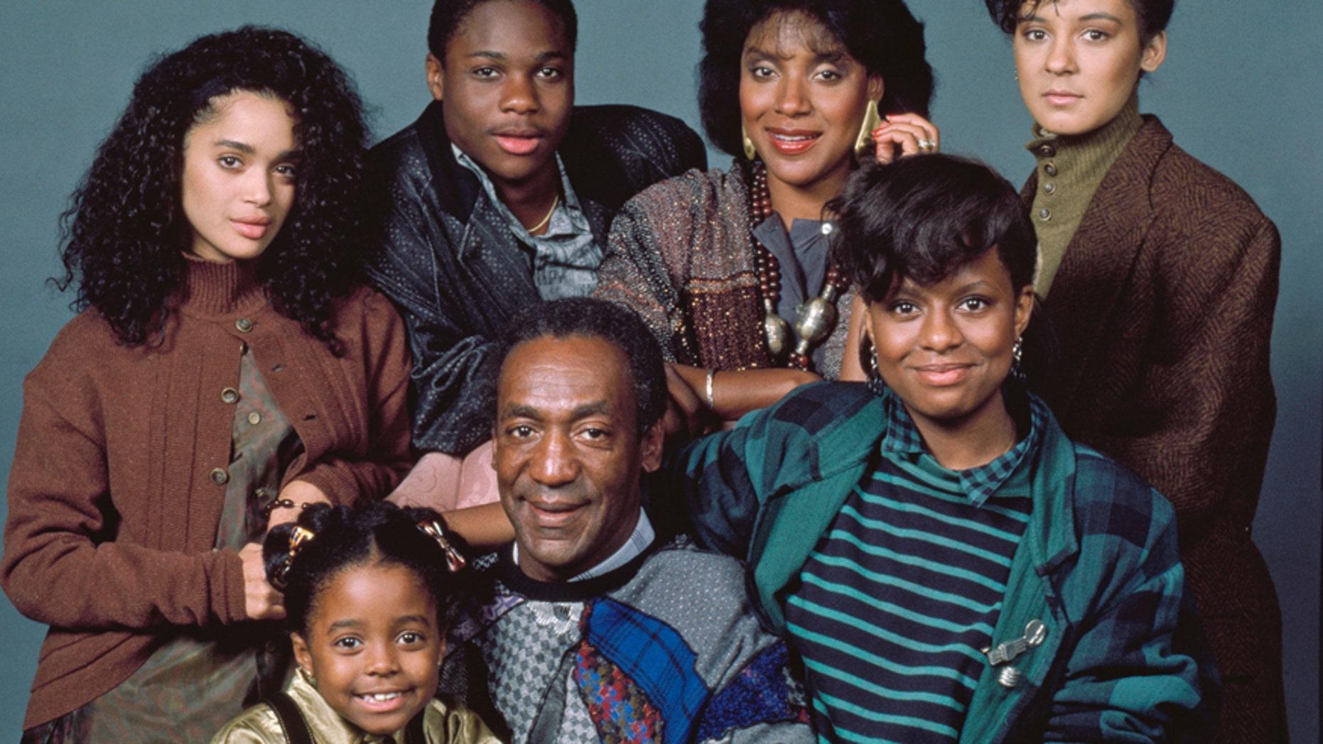 Pictured: (back row, l-r) Lisa Bonet as Denise Huxtable, Malcolm-Jamal Warner as Theodore 'Theo' Huxtable, Phylicia Rashad as Clair Hanks Huxtable, Sabrina Le Beauf as Sondra Huxtable Tibideaux, (front row, l-r) Keshia Knight Pulliam as Rudy Huxtable, Bill Cosby as Dr. Heathcliff 'Cliff' Huxtable, Tempestt Bledsoe as Vanessa Huxtable.