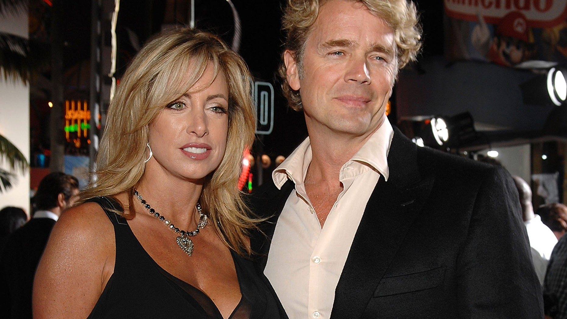 """Actor John Schneider (right) and wife Elly Castle arrives to the premiere of """"Elizabeth: The Golden Age"""" at Universal City Walk on October 1, 2007 in Universal City, California."""
