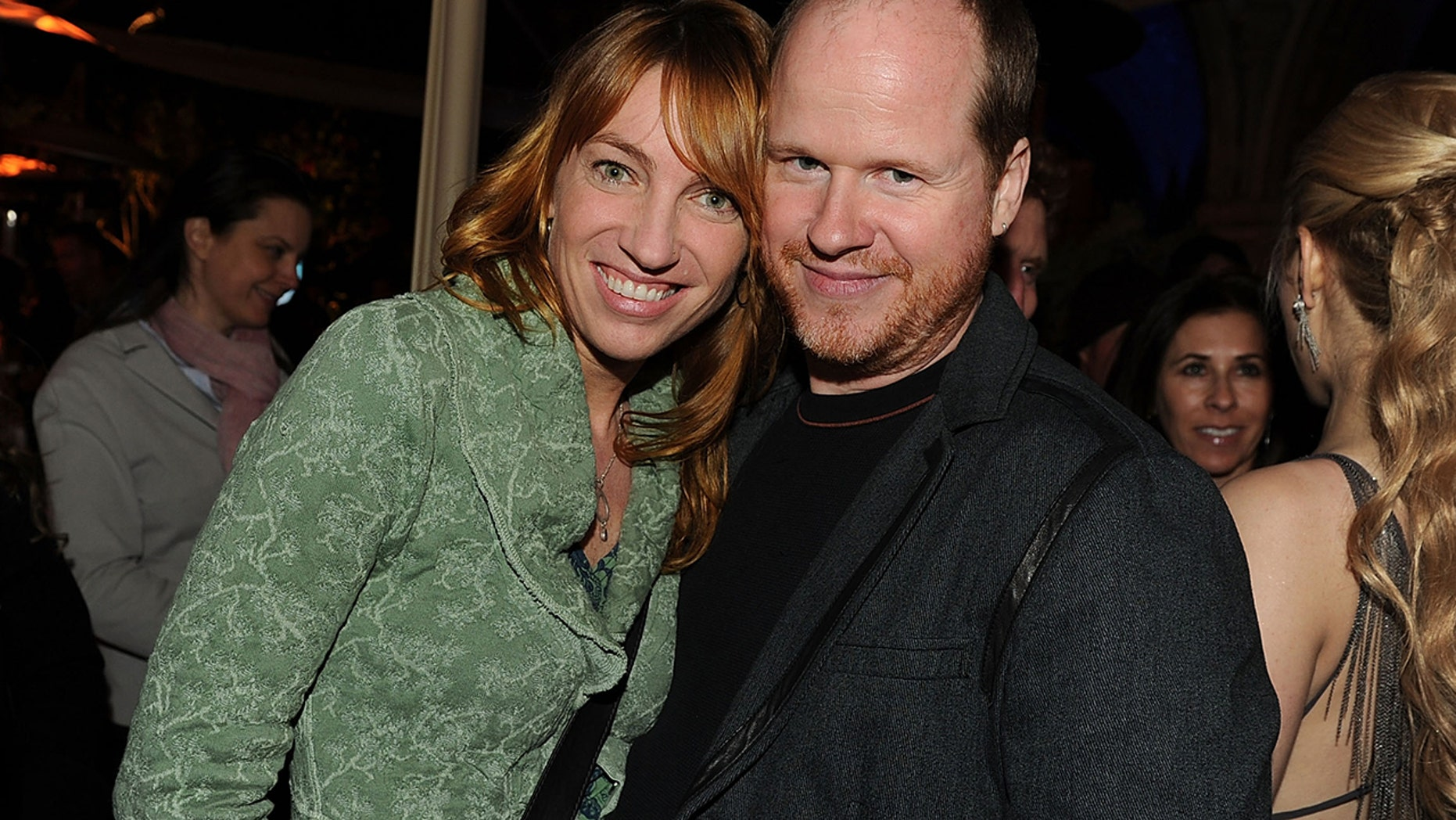"Kai Cole (L) and director Joss Whedon attend Fox's ""Glee"" spring premiere soiree held at Bar Marmont on April 12, 2010 in Los Angeles, California."