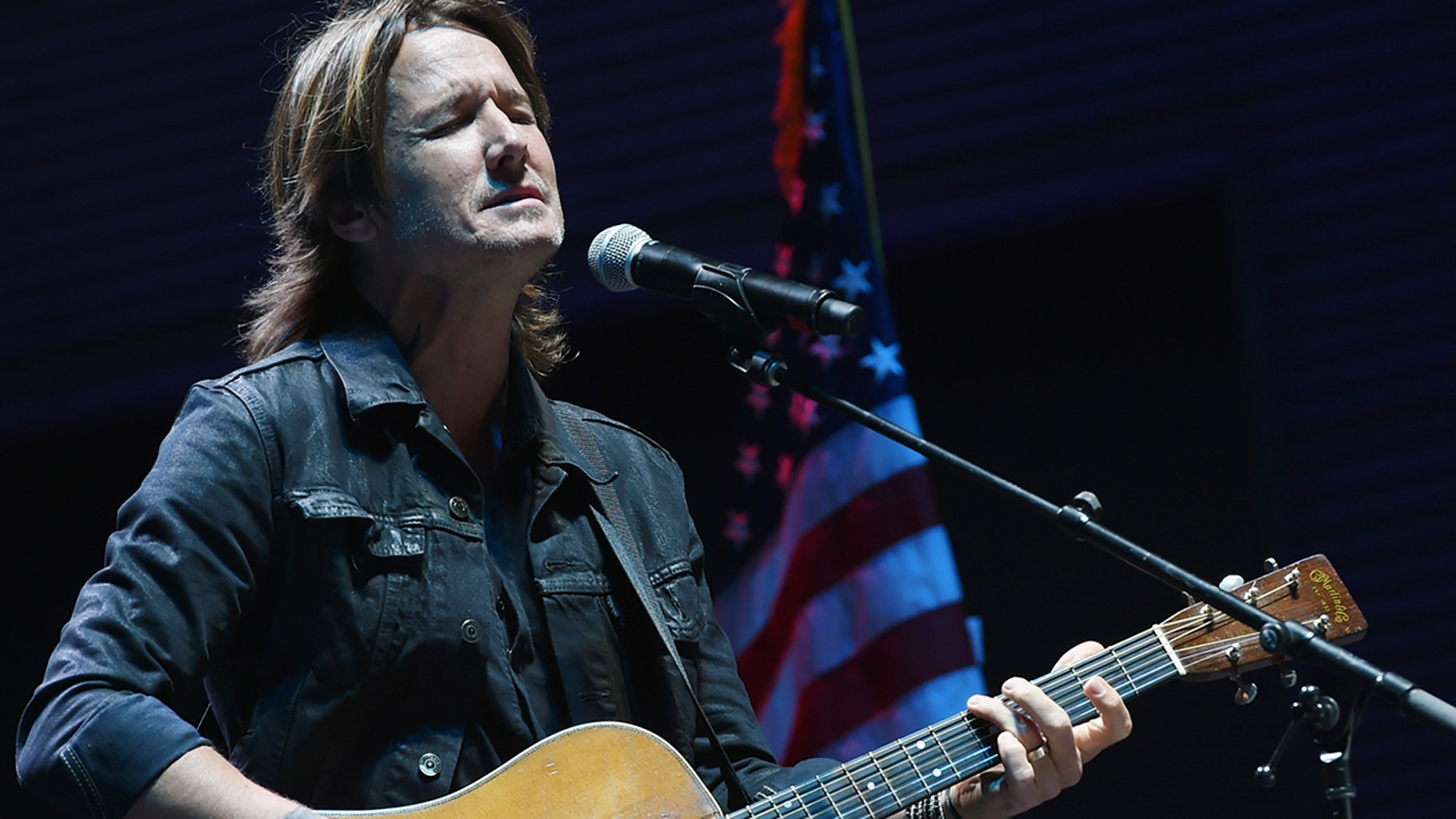Keith Urban performs 'Bridge Over Troubled Water' during Nashville Candelight Vigil For Las Vegas at Ascend Amphitheater on October 2, 2017 in Nashville, Tennessee.