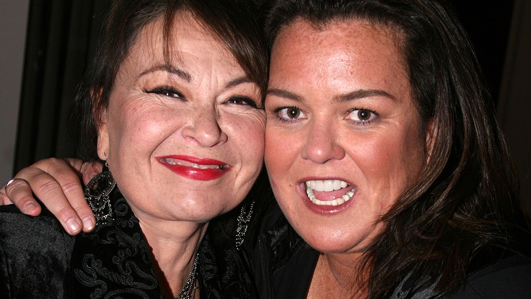 Rosie O'Donnell and Roseanne Barr pose backstage at The 4th Annual New York Comedy Festival at Lincoln Center's Avery Fisher Hall on November 6, 2007 in New York.