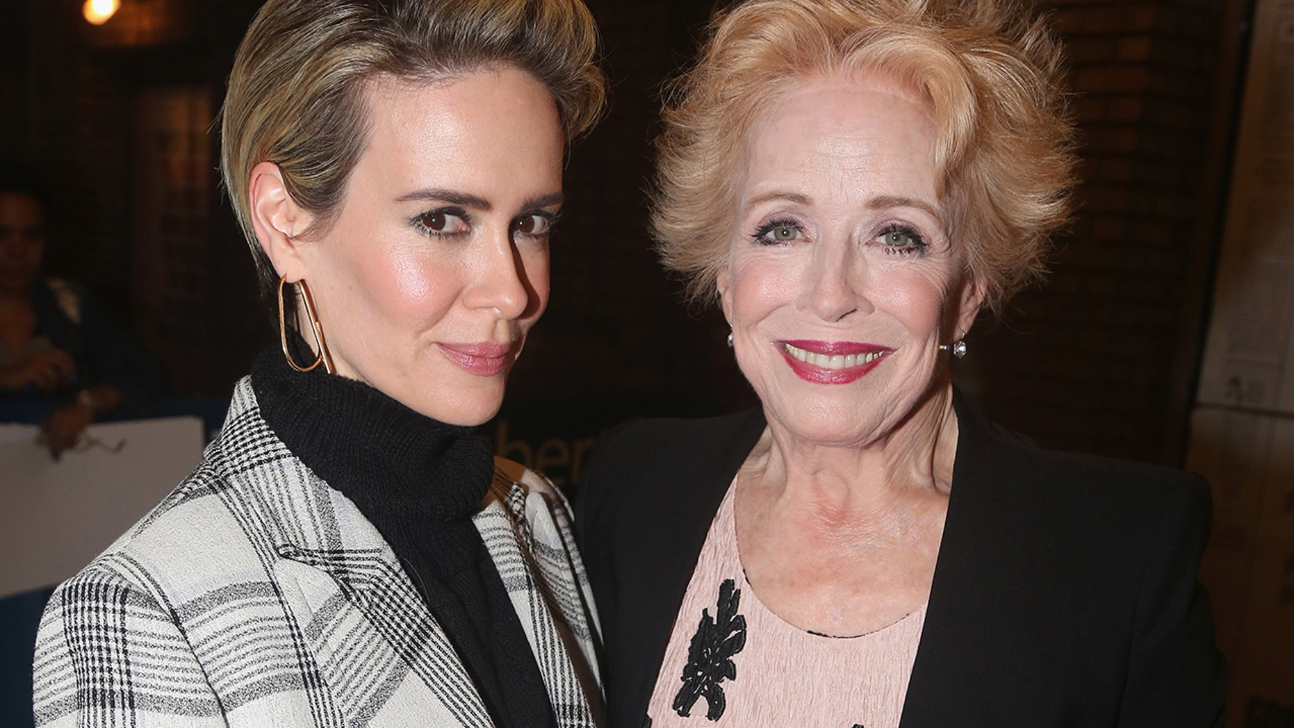 """Sarah Paulson and girlfriend Holland Taylor pose at The Opening Night of """"The Front Page"""" on Broadway at The Broadhurst Theatre on October 20, 2016 in New York City."""