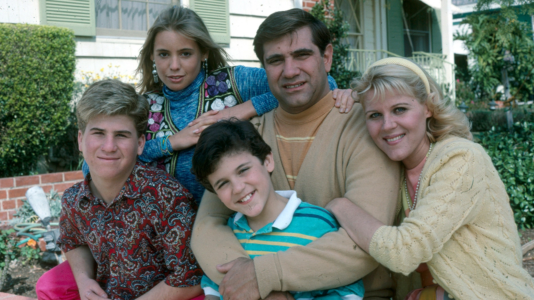 """From l-r: Jason Hervey, Olivia D'Abo, Fred Savage, Dan Lauria, Alley Mills of """"The Wonder Years."""""""