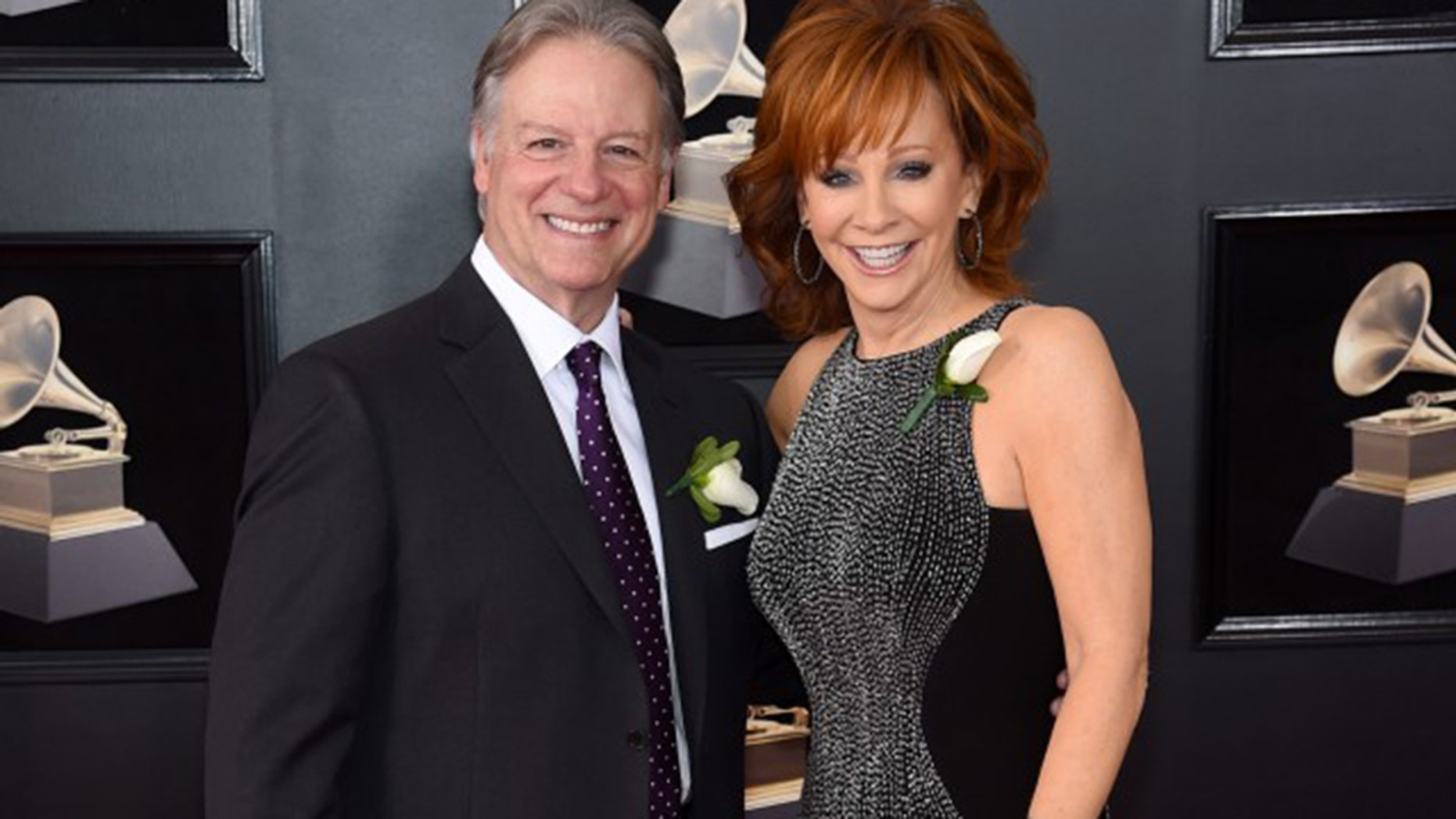 Reba walked the Grammys red carpet with her new boyfriend Anthony Lasuzzo.