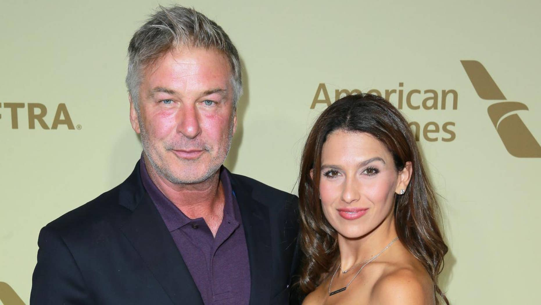 Alec Baldwin, left, and wife Hilaria welcome son Romeo on May 17.