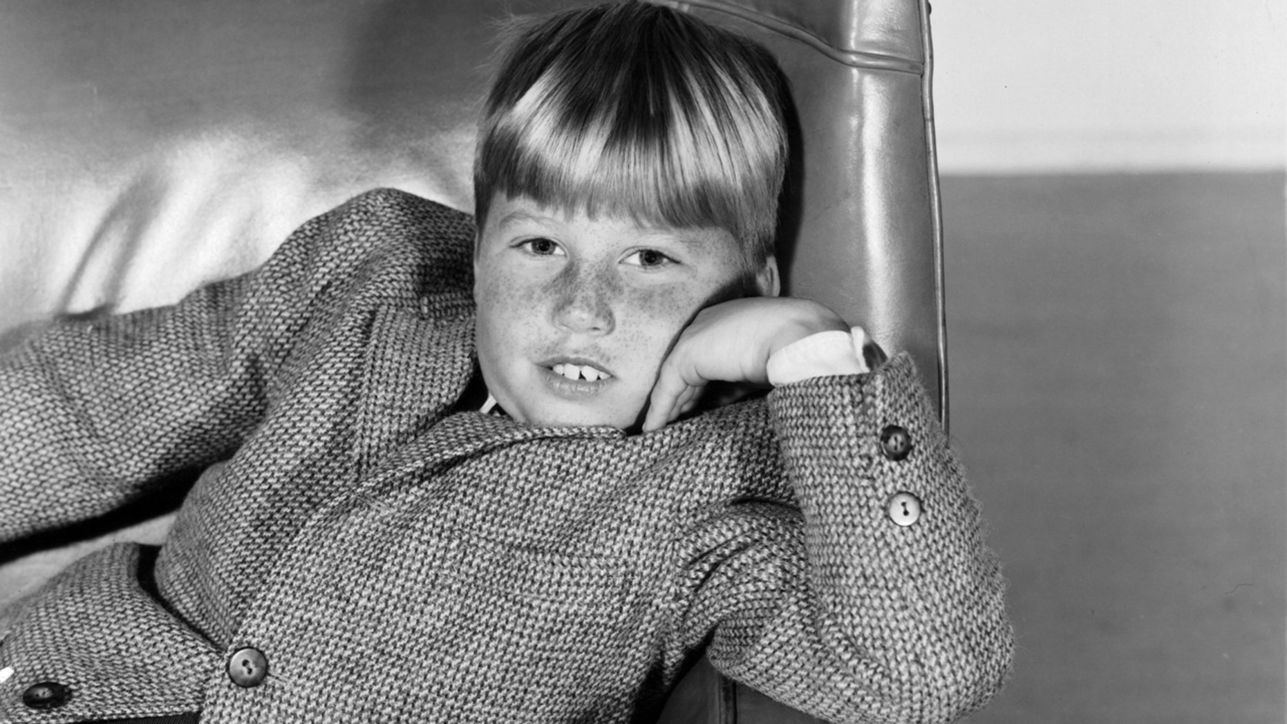 Teddy Rooney sitting in chair in publicity portrait for the film 'Andy Hardy Comes Home', 1958. (Photo by Metro-Goldwyn-Mayer/Getty Images)
