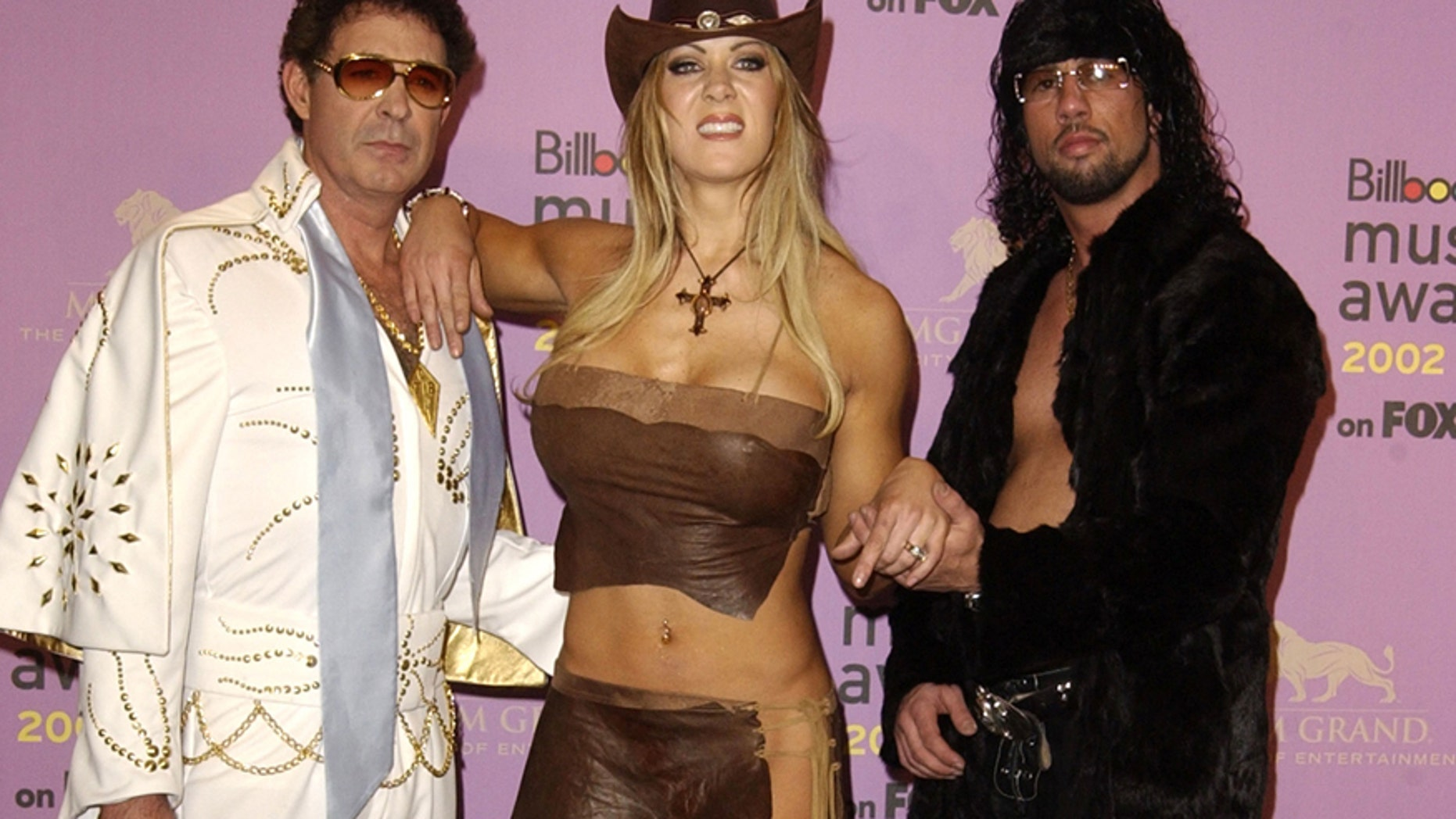 """From l-r: Barry Williams, Joanie """"Chyna"""" Laurer and Sean Waltman aka: X PAC at the MGM Grand Arena in Las Vegas, Nevada, December 9, 2002."""
