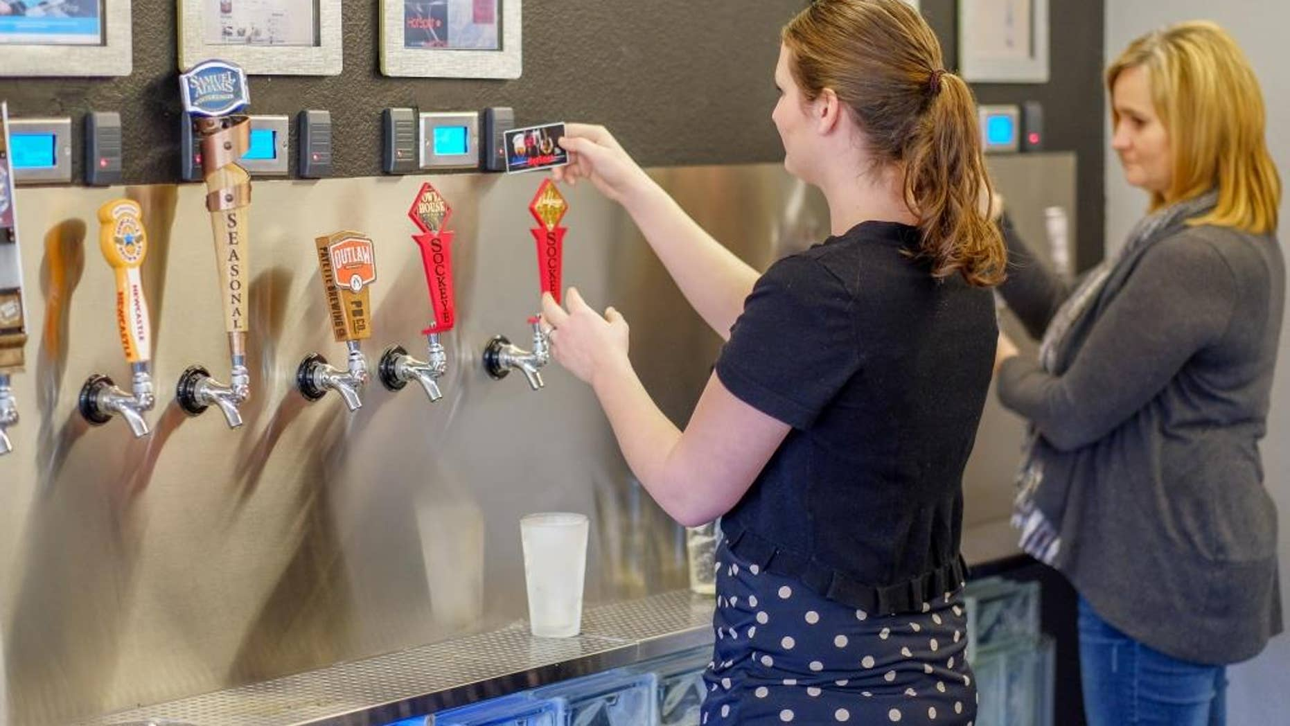 Bar goers test out the newly installed system.