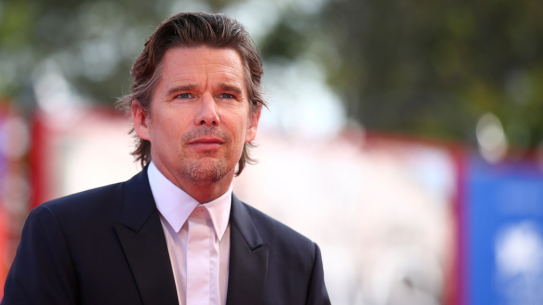 "Actor Ethan Hawke poses during a red carpet event for the movie ""First reformed"" at the 74th Venice Film Festival in Venice, Italy August 31, 2017. REUTERS/Alessandro Bianchi - RC1960E14200"