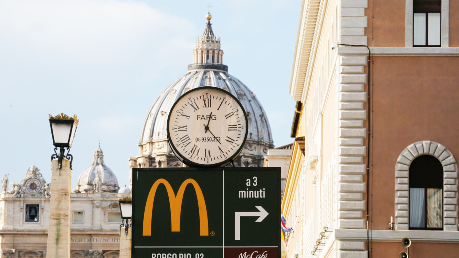 A McDonald's sign is seen at Via della Conciliazione street in Rome, Italy in front of Vatican City's St. Peter's Square Jan. 3, 2017.