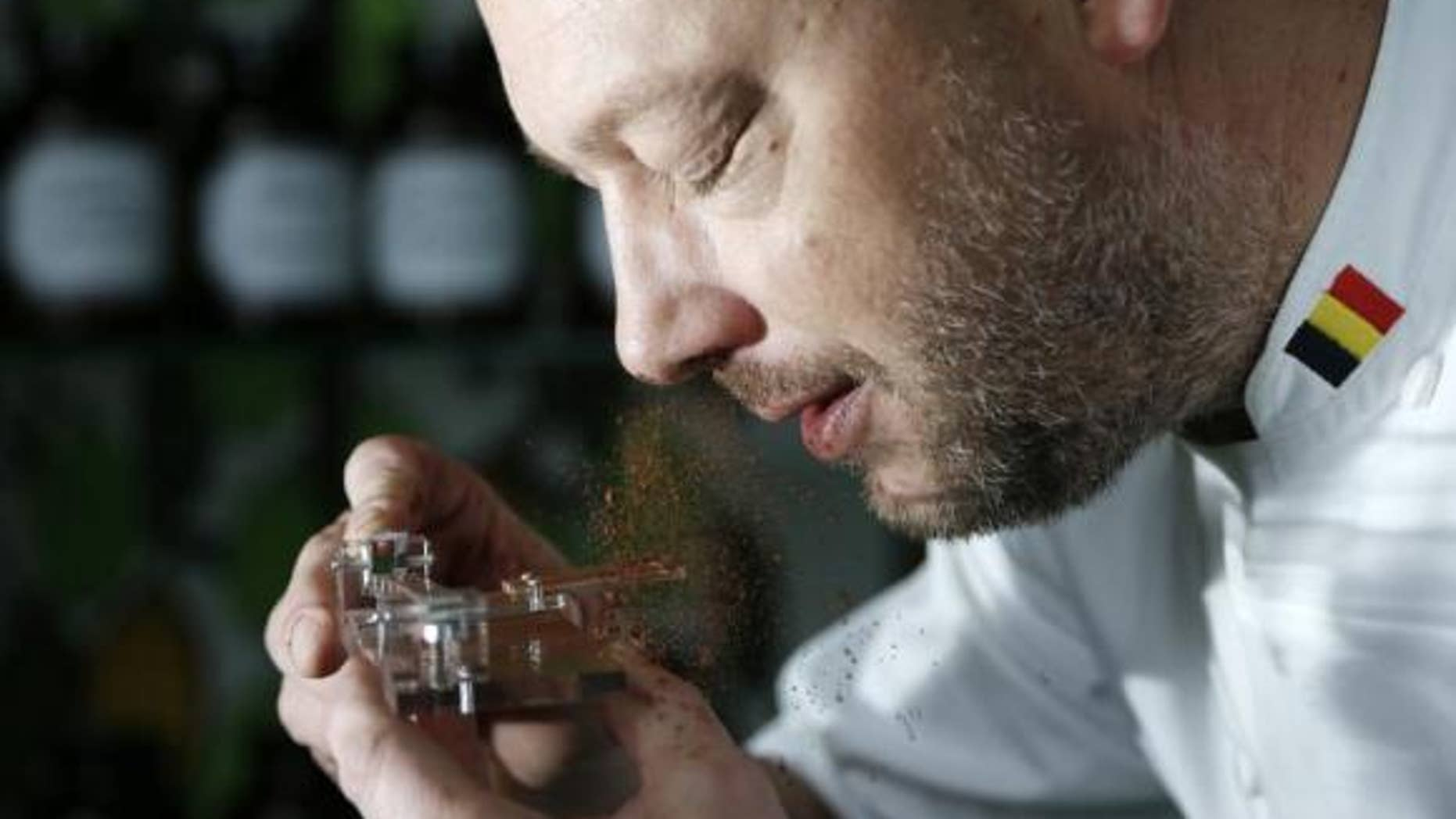 Belgian chocolatier Dominique Persoone snorts cocoa powder off his Chocolate Shooter device. Reuters
