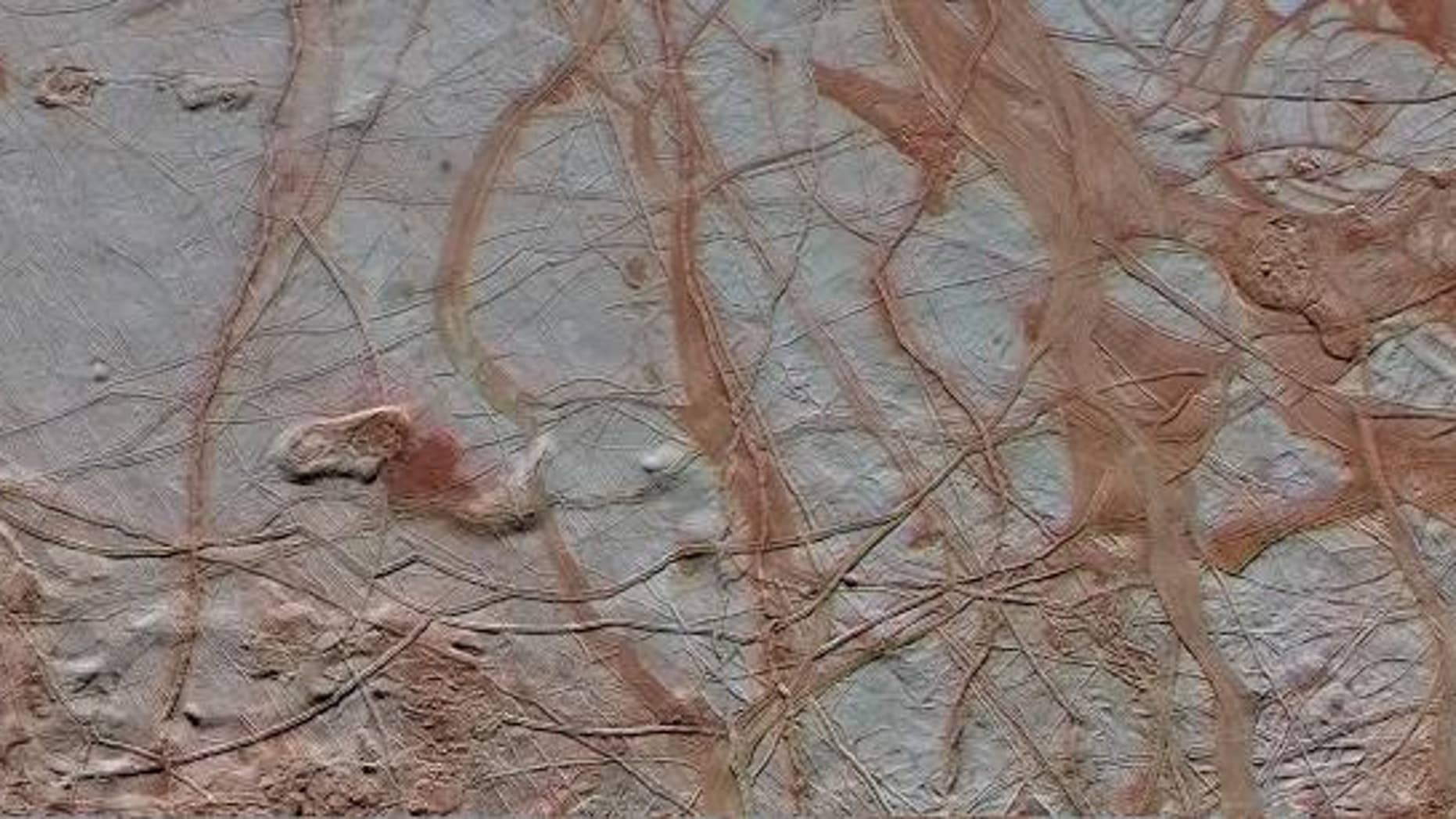 This enhanced-color view shows a swath of Jupiter's moon Europa that's 217 miles wide by 466 miles long (350 by 750 kilometers). New research suggests that Europa's surface could be 95 percent porous, meaning a probe might sink if it landed there.
