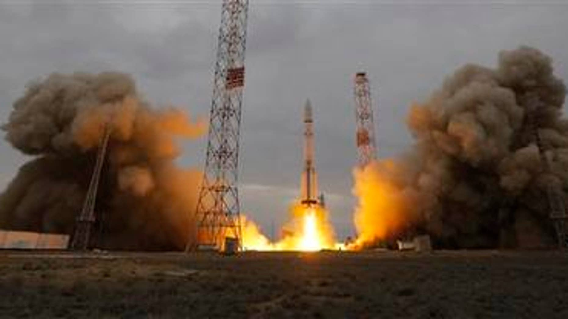The Proton-M rocket booster blasts off at the Russian leased Baikonur cosmodrome, Kazakhstan, Monday, March 14, 2016. Europe and Russia launched a joint mission Monday to explore the atmosphere of Mars and hunt for signs of life on the red planet. (AP Photo/Dmitri Lovetsky)