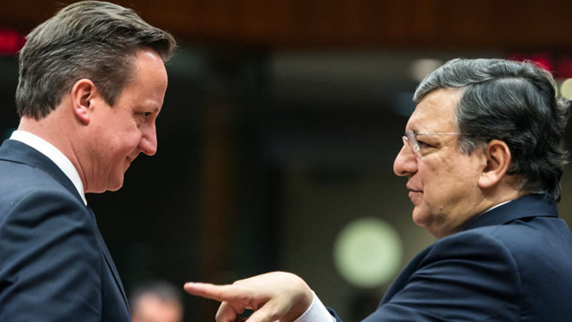 Mar. 20, 2014: European Commission President Jose Manuel Barroso, right, gestures while speaking with British Prime Minister David Cameron during a round table meeting an EU summit in Brussels.