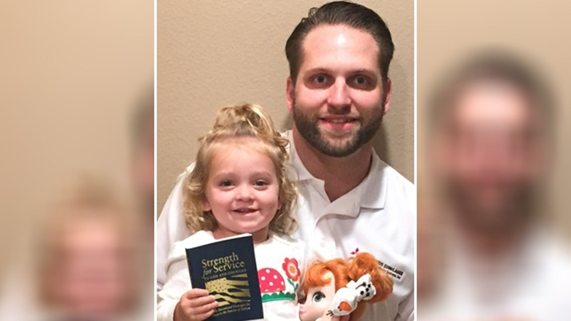 """Evan Hunsberger, 29, seen here with his daughter Caydence, has worked tirelessly since the age of 13 to reprint and distribute """"Strength or Service for God and Country."""" (Courtesy of Evan Hunsberger)"""