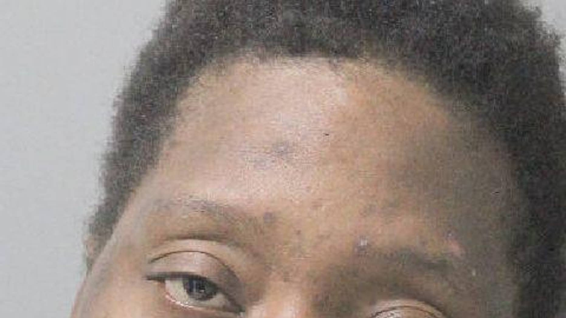 Evelyn Washington was charged with burglary after she was busted in another woman's home taking a bath and eating some Cheetos, police say.
