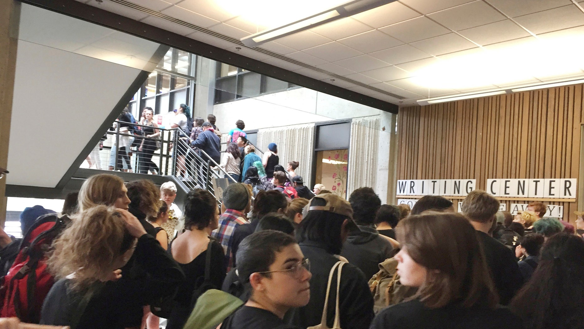 In this Wednesday, May 24, 2017, photo, after weeks of brewing racial tension on campus, hundreds of students at the Evergreen State College in Olympia, Wash., protest against the college administration and demanded change.