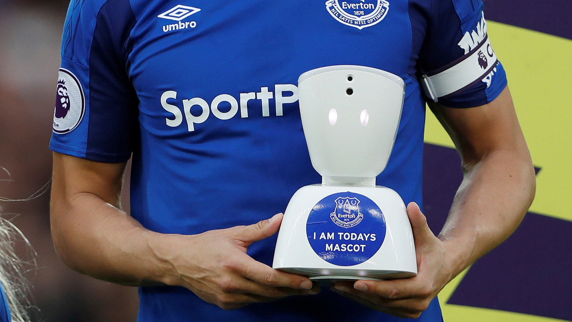 Everton v Newcastle United - Goodison Park, Liverpool, Britain - April 23, 2018 Everton's Phil Jagielka with a robot mascot before the match (Action Images via Reuters/Lee Smith)