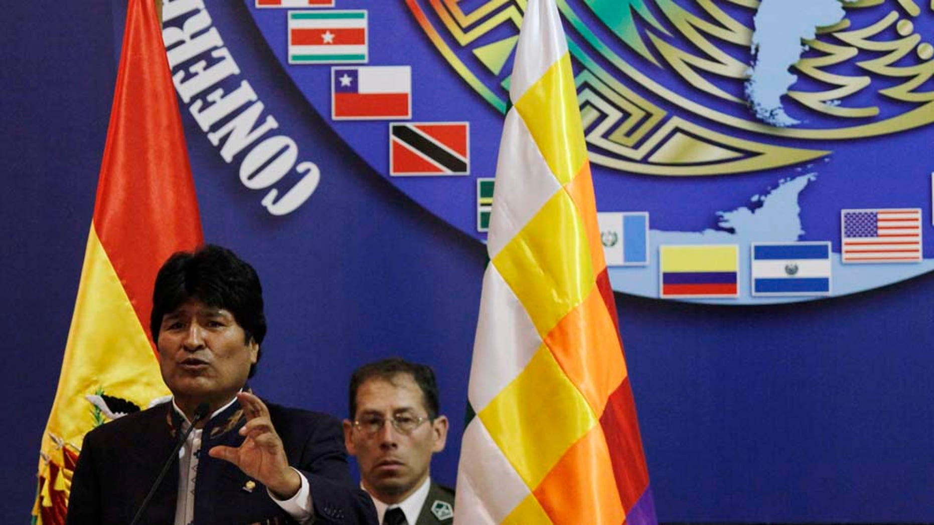 Bolivia's President Evo Morales speaks during the opening of the Ninth Conference of Defense Ministers of the Americas (CDMA) in Santa Cruz, Bolivia, Monday Nov. 22, 2010.  (AP Photo/Juan Karita)