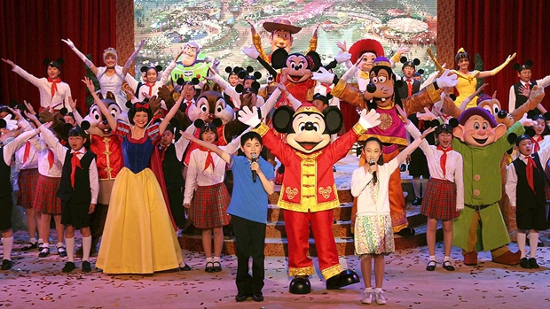 Chinese children perform with Disney actors to celebrate the ground-breaking of Shanghai Disneyland in 2011.