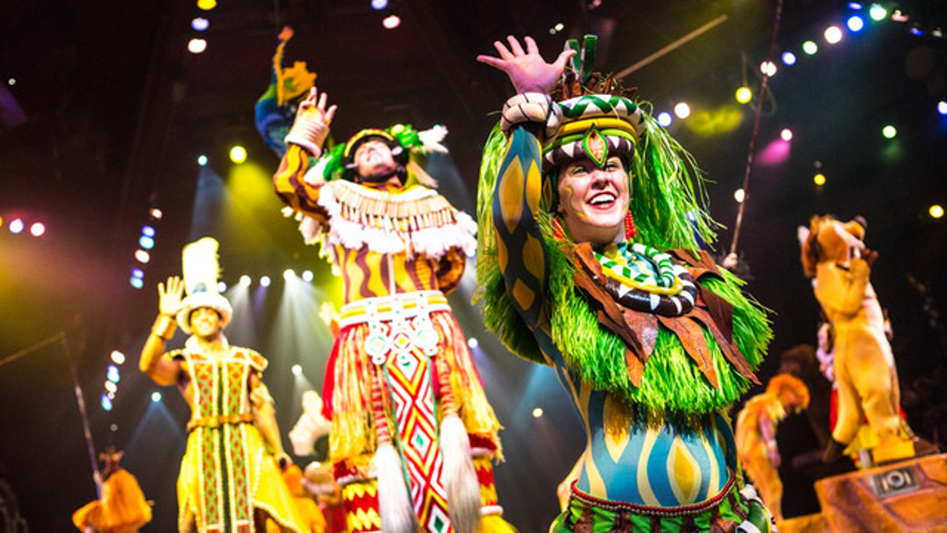 "Performers greet the audience during ""Festival of the Lion King."""