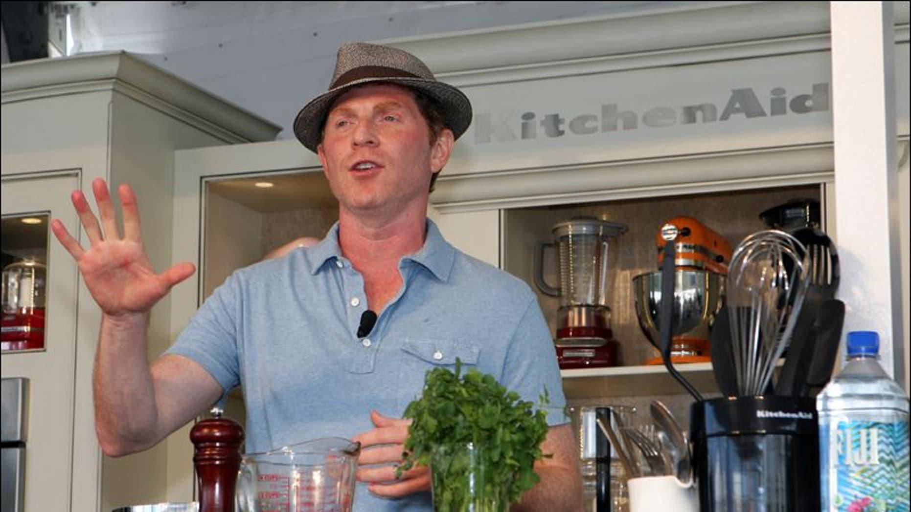 Food Network star Bobby Flay performs an outdoor kitchen demo at the South Beach Wine & Food Festival in Miami.