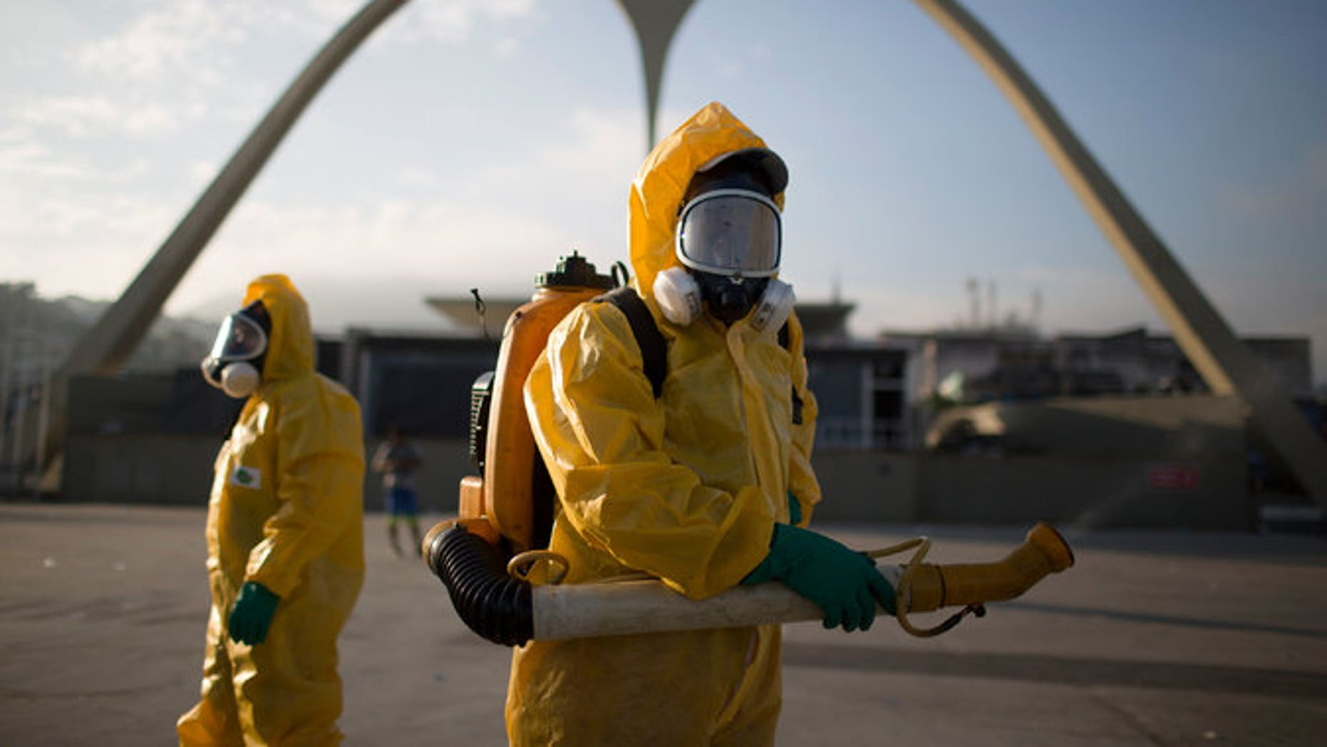 Health workers in  Rio de Janeiro spray insecticide around Olympic properties to combat the mosquito known to transmit the Zika virus.