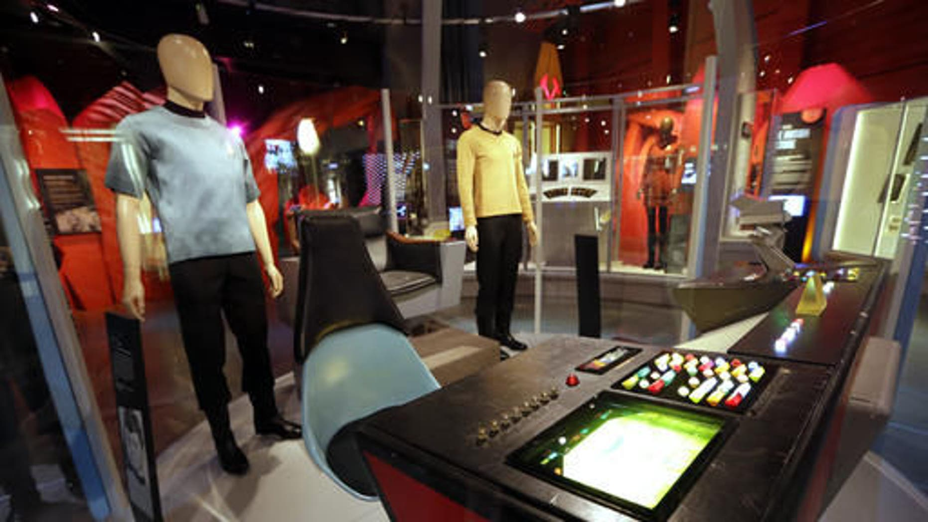 """Costumes and pieces of the set of the """"Star Trek"""" TV series are displayed in the exhibit, """"Star Trek: Exploring New Worlds,"""" as part of a 50th anniversary celebration of the TV show and films at the EMP Museum, in Seattle. The exhibit opens on Saturday."""