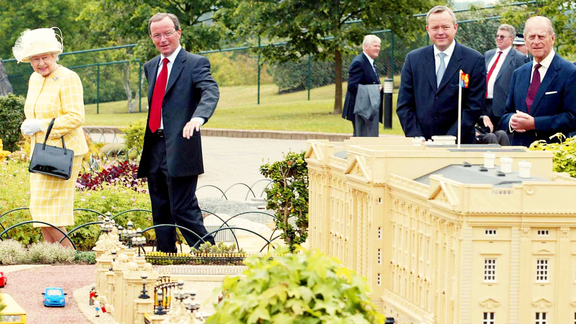 Queen Elizabeth (L) and the Duke of Edinburgh look at a miniature version of Buckingham Palace during a visit to Legoland in Windsor, U.K.