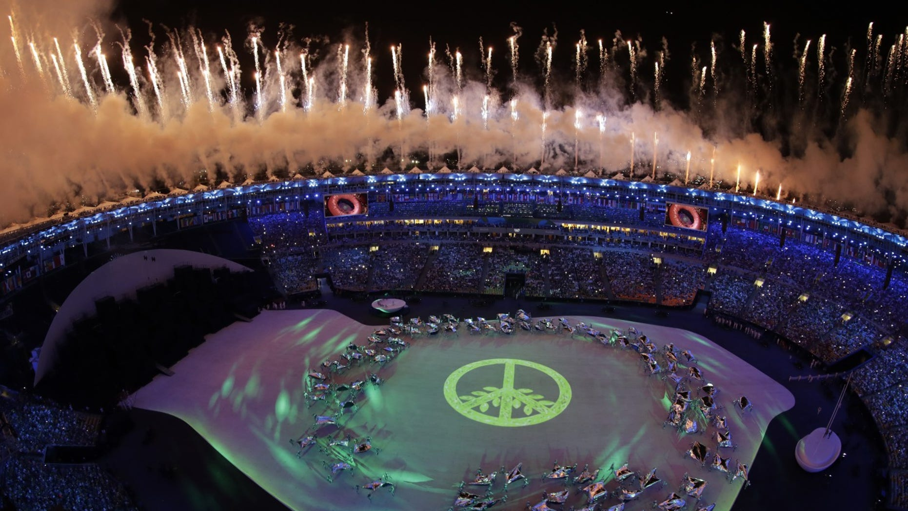 Fireworks light up the night sky over Maracana Stadium during the opening ceremony at the 2016 Summer Olympics in Rio de Janeiro, Brazil, Friday, Aug. 5, 2016.