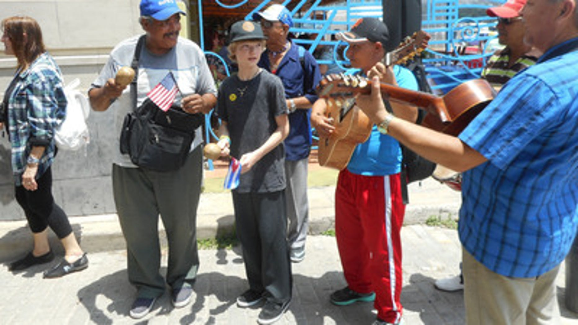 Flags exchanged with street vendors and musicians in Old Havana.