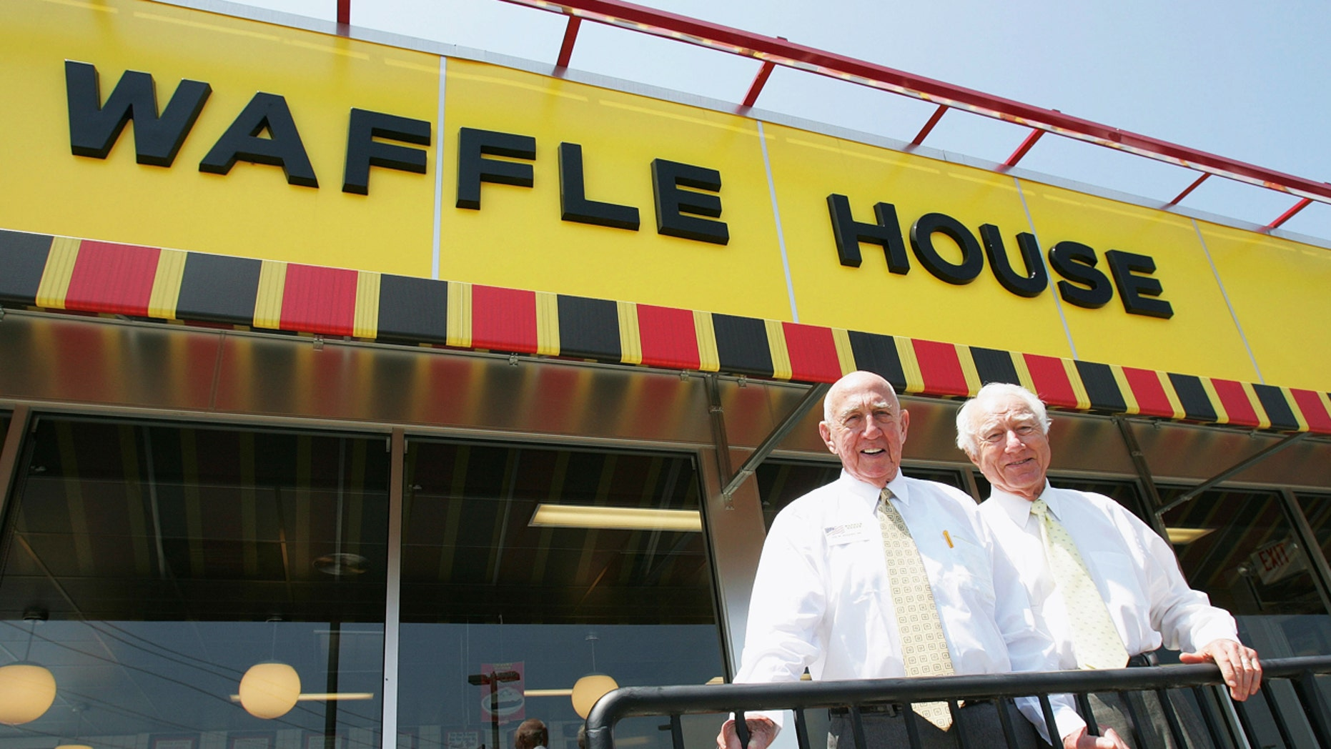 FILE - In this file photo taken July 26, 2005, Waffle House founders Joe Rogers Sr., left, and Thomas Francis Forkner Sr. pose in front of a Waffle House restaurant after eating lunch at the establishment in Norcross, Ga. Forkner, who jumped from real estate to the restaurant business when he co-founded Waffle House in the 1950s, has died weeks after the death of his business partner who helped him create the famous Southern diner chain. Waffle House said in a statement that Forkner died Wednesday, April 26, 2017, at age 98. (AP Photo/Ric Feld, File)