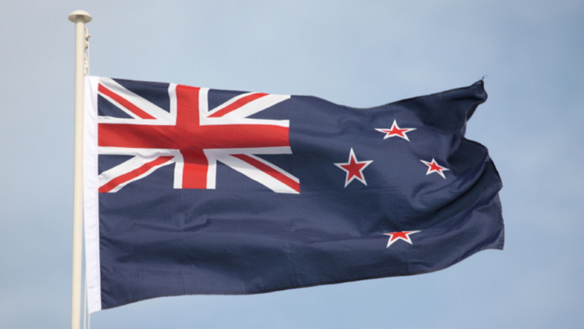 The New Zealand flag flying in strong wind. Some motion on flag edges.