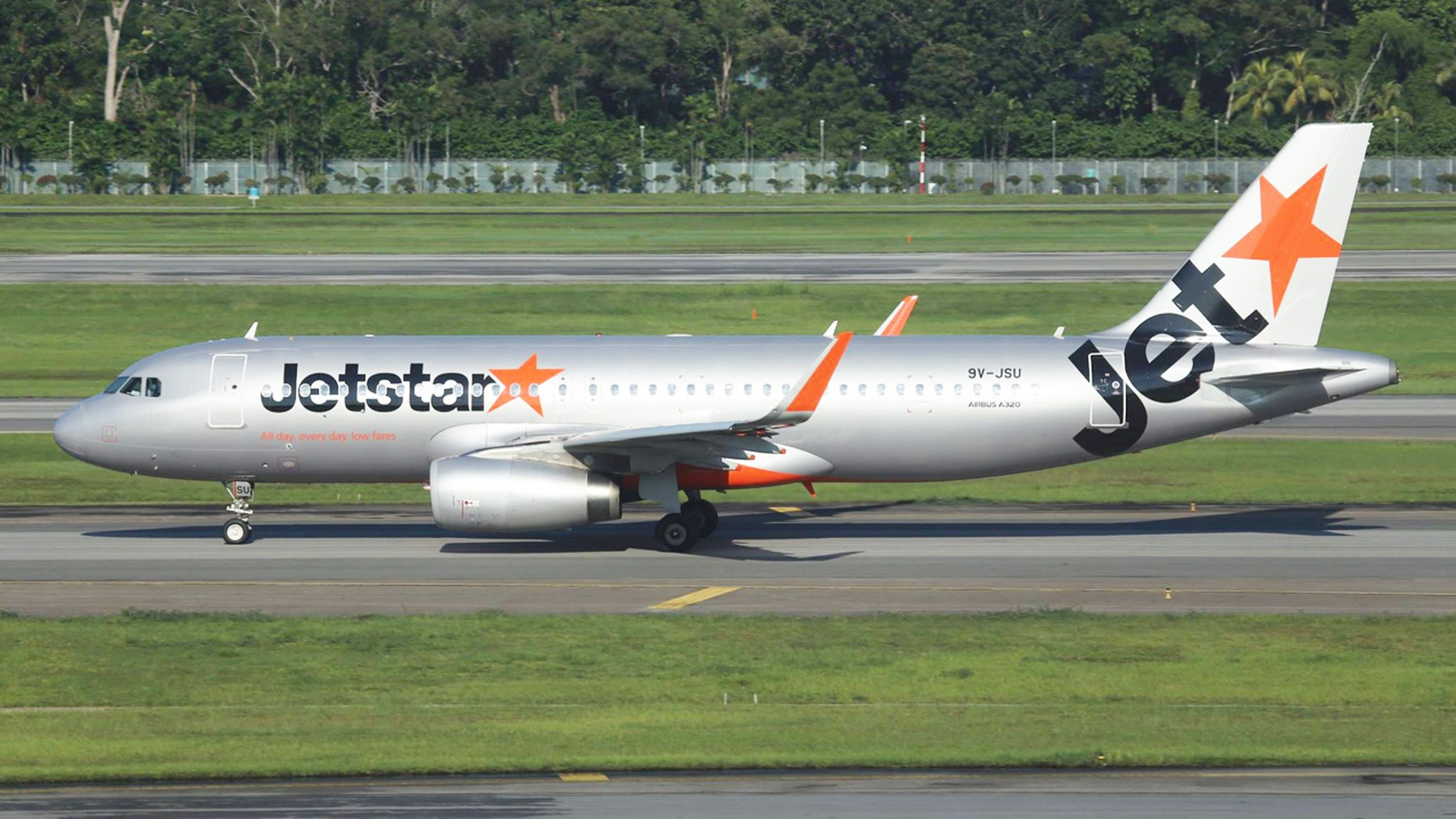 A mother celebrated the birth of her healthy newborn aboard a Jetstar Asia plane by naming her baby after the airline.