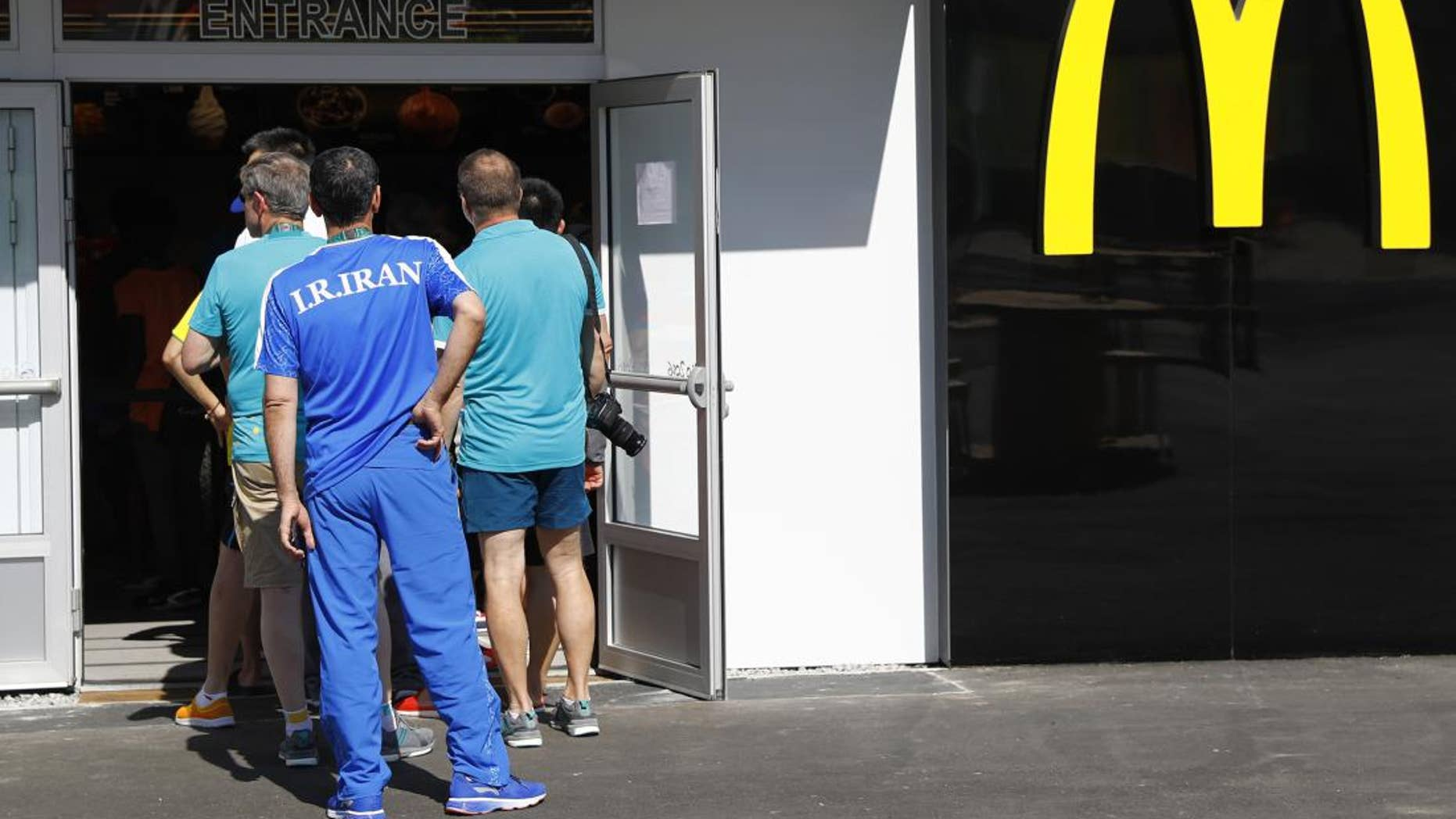A line forms outside the Olympic Village McDonald's outpost in  Rio de Janeiro, Brazil.