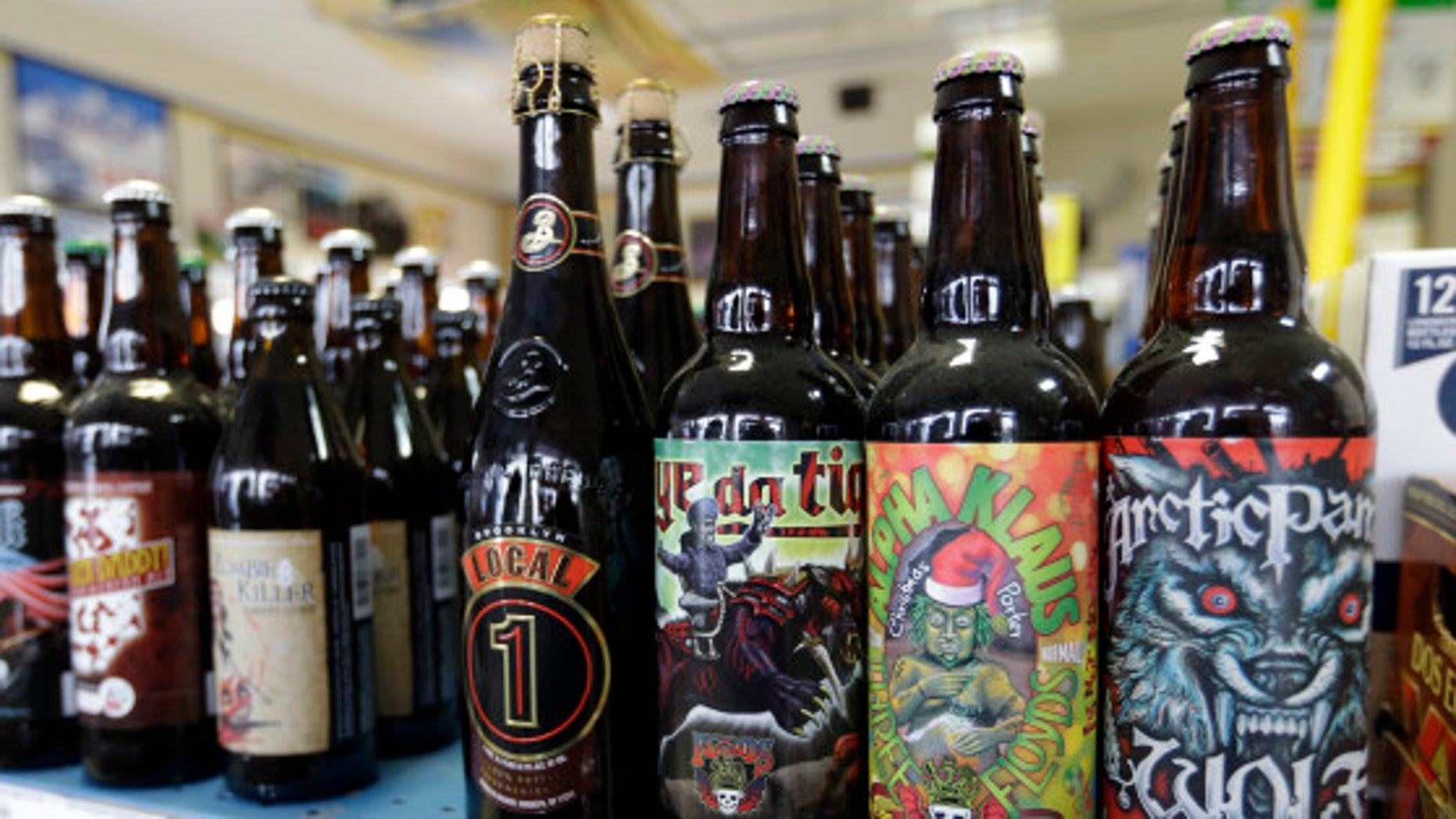 A selection of craft beers dot the shelves of Elite Beverages in Indianapolis, Ind. Craft beers now account for approximately 20 percent of the domestic beer market share.