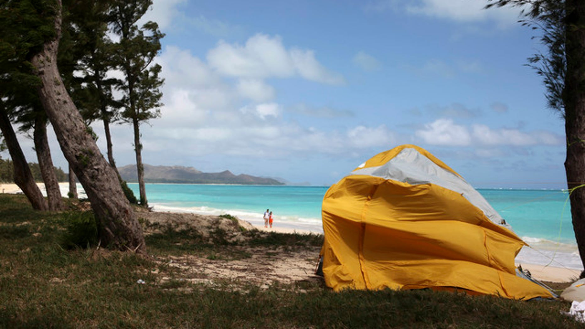 A tent sits on Waimanalo Beach, one of the state's world-class beaches, in Waimanalo, Hawaii today. A bill is being considered by Hawaii lawmakers this session to crack down on a growing market in the state.