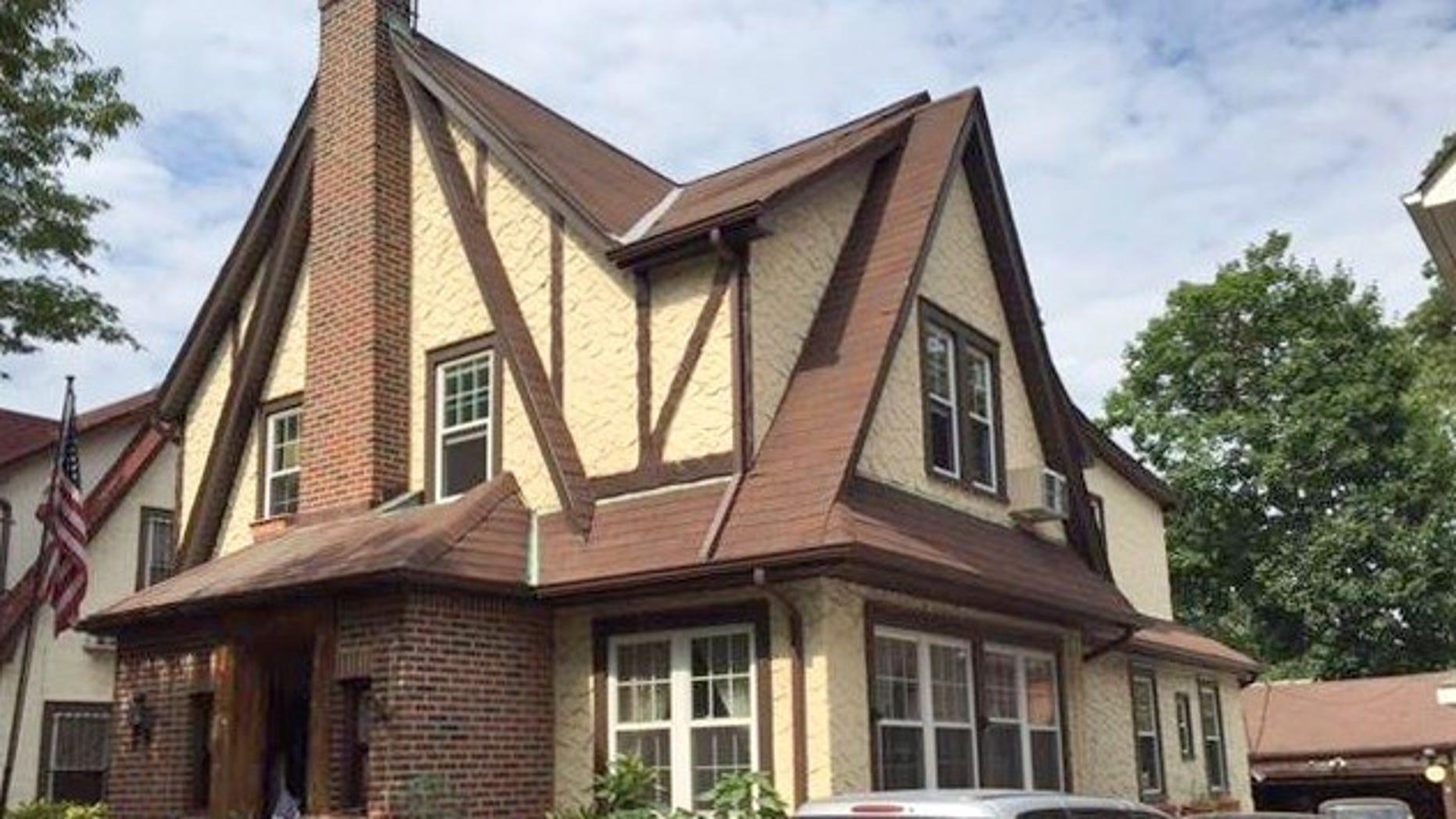 The Tudor-style home has a brick-and-stucco façade.