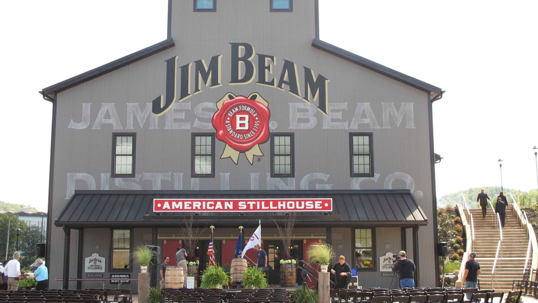 FILE - This Oct. 3, 2012 file photo shows the Jim Beam visitors center at its central distillery in Clermont, Ky.  Another round of voting produced the same results in a labor dispute for the company behind Jim Beam whiskey, as workers at two Kentucky distilleries rejected a revised contract offer Friday, Oct. 14, 2016 with a strike looming.  (AP Photo/Bruce Schreiner)