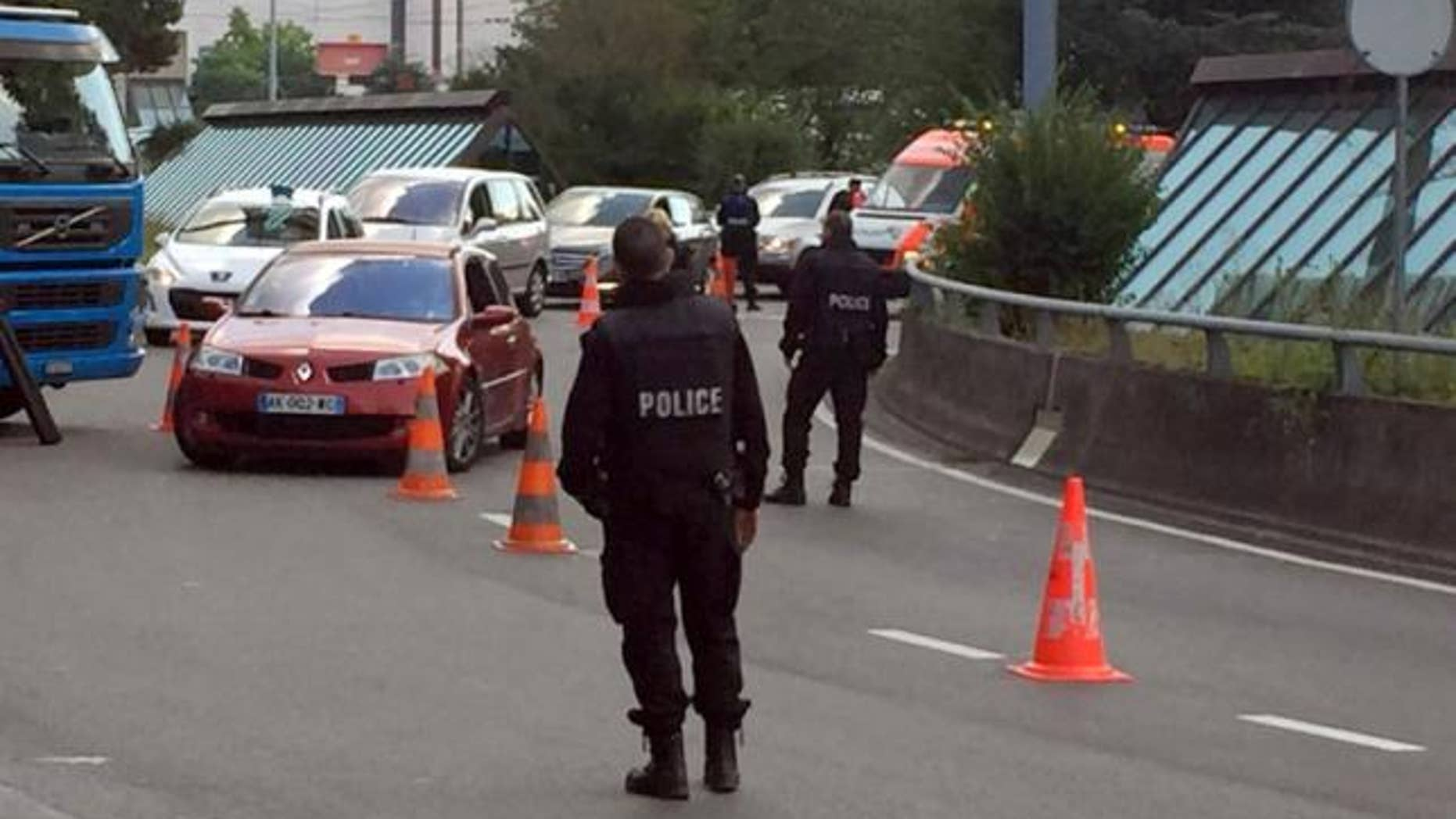 Swiss police conduct checks on cars at the entrance of the Cointrin airport in Geneva, Switzerland July 27, 2016. Authorities later determined called in a fake bomb threat to keep her husband from flying.