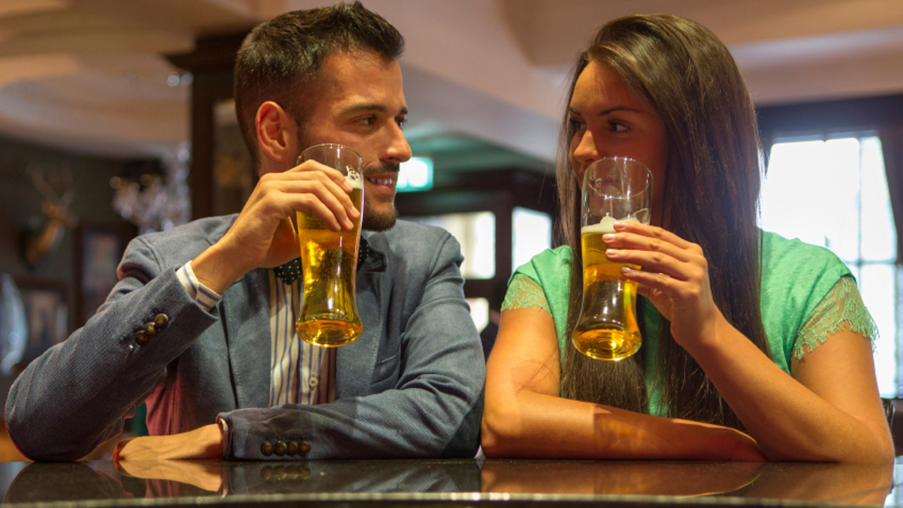 Men and women really do drink differently.