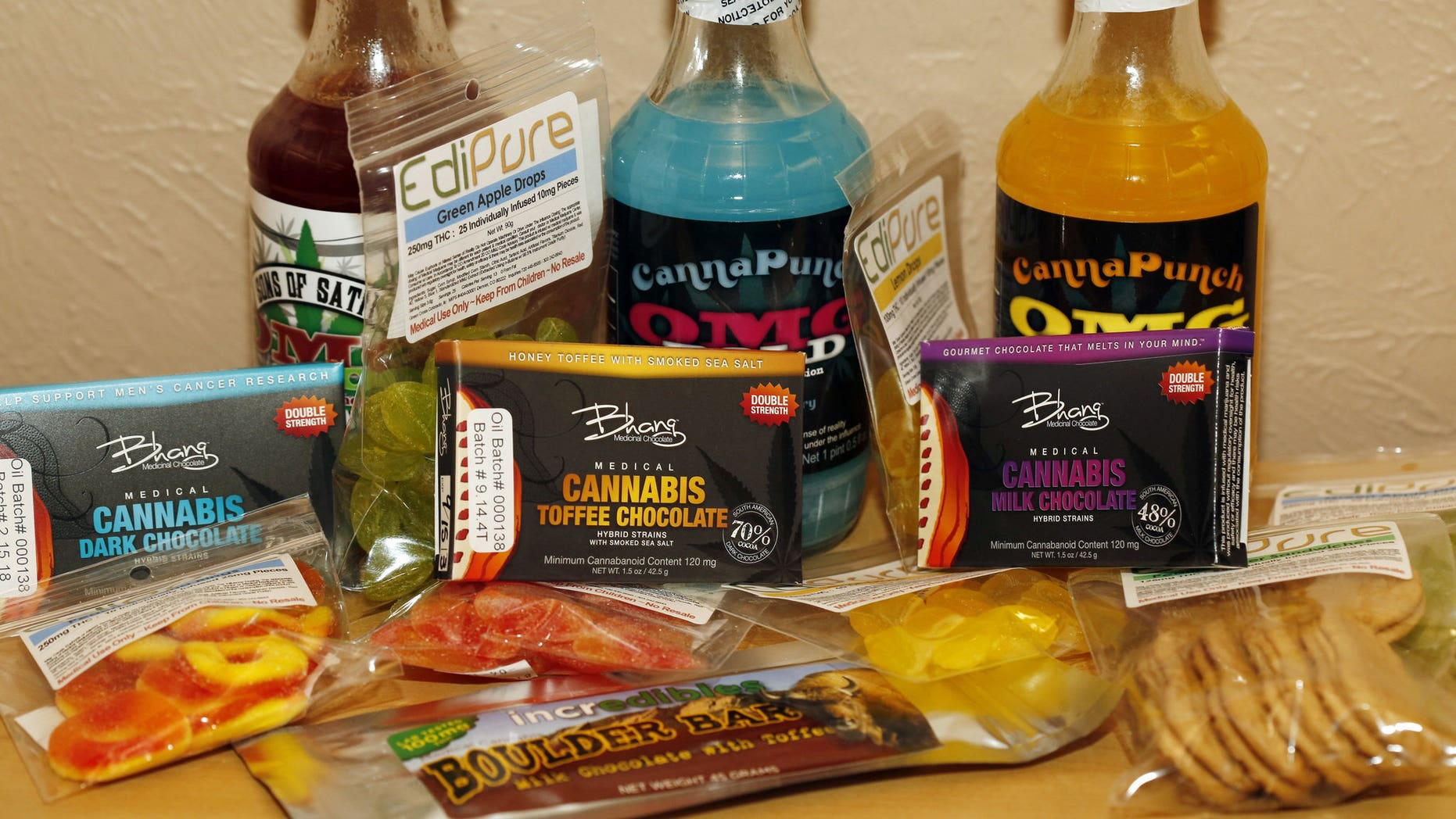 A sample of marijuana-infused edible including fruit gummies, chocolate and beverages.