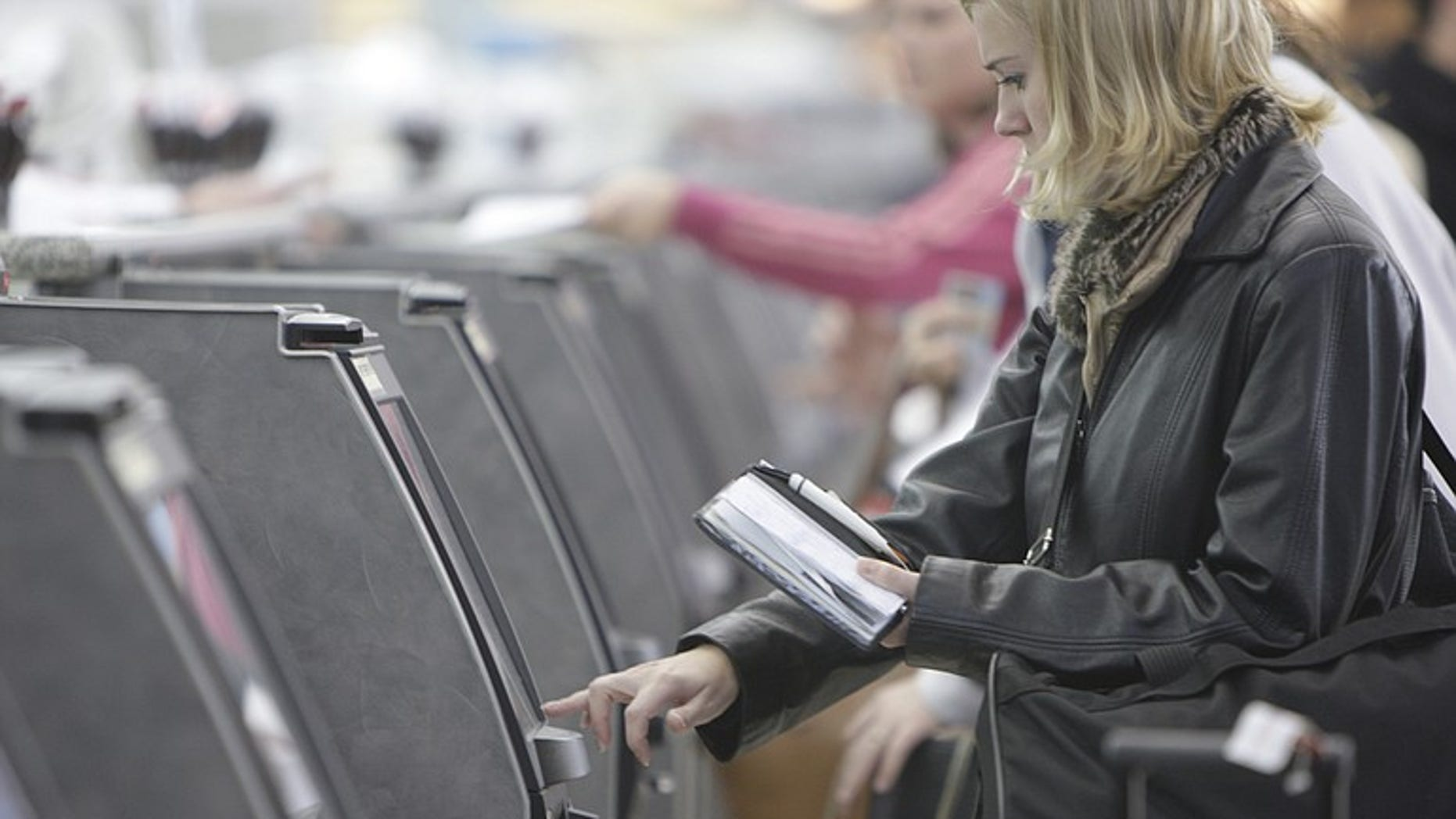 An American Airlines passenger checks into a ticket kiosk at Lambert St. Louis International Airport.